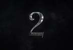 O número dois no meio de nuvens negras, estilizado para parecer metálico, como nos logos da série.