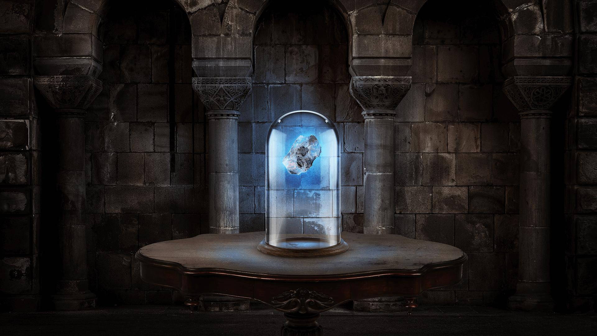 Numa sala com paredes antigas, uma mesa sustenta uma redoma cilíndrica onde, dentro, há uma pedra azul brilhante.