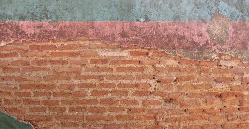 A decaying wall. The old painting was clearly a trans flag. It is now mostly a brick wall.