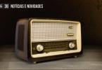 """Foto de um rádio antigo sobre uma mesa de madeira. No topo, o texto """"Animagos 38 - Notícias e novidades""""."""